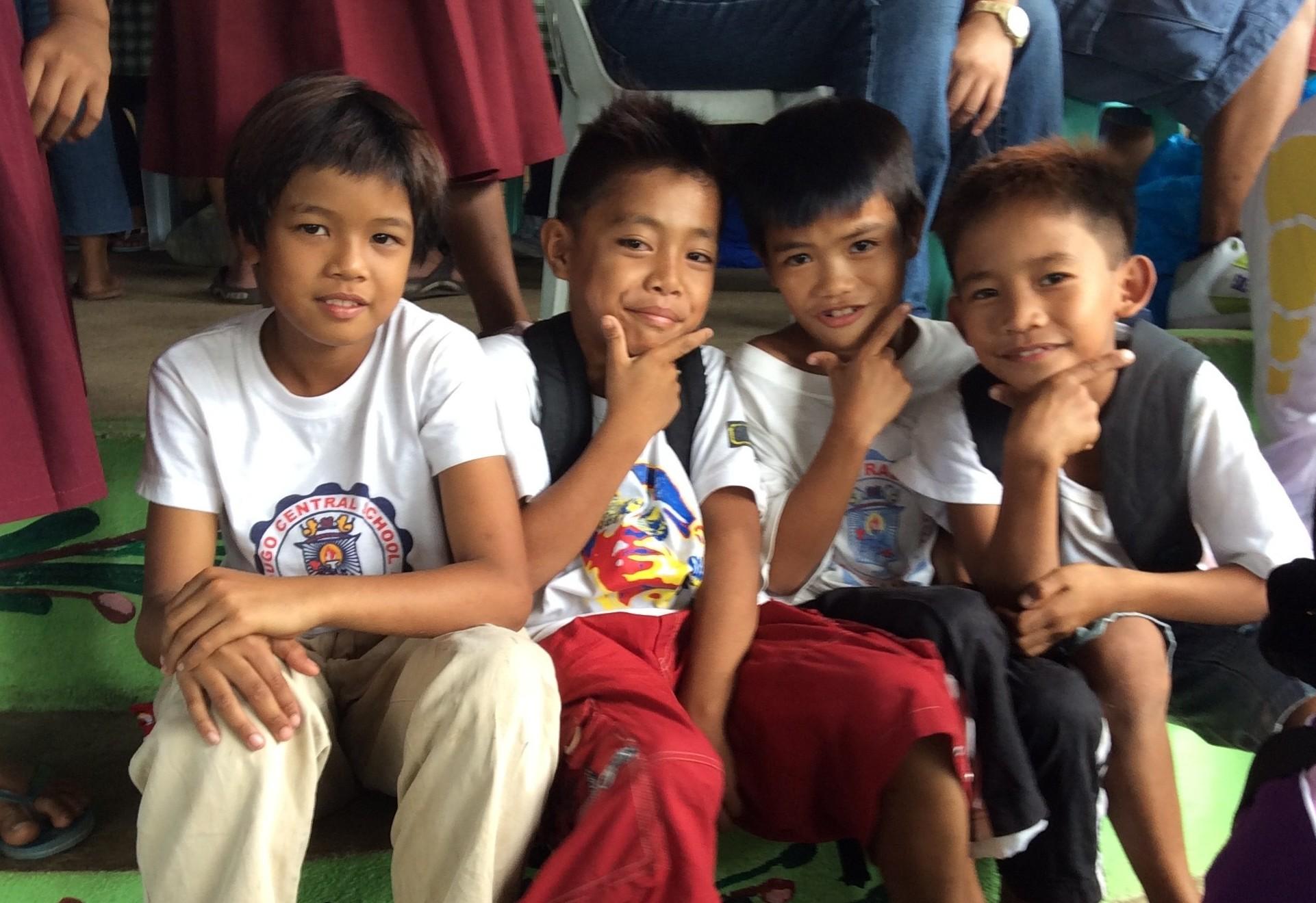 School boys enjoying their new supplies.